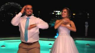 Bride and Groom surprise guests with funny wedding dance