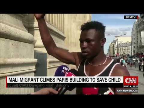 Malian migrant in France saves young child dangling from a balcony thumbnail