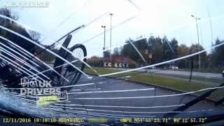 Caught on UK Dash cam - Cyclist crashes head first into oncoming car. Accident caught on camera