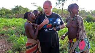 Africa: Girls are shocked by a white man. Wild Hamer tribe traditions and rituals.