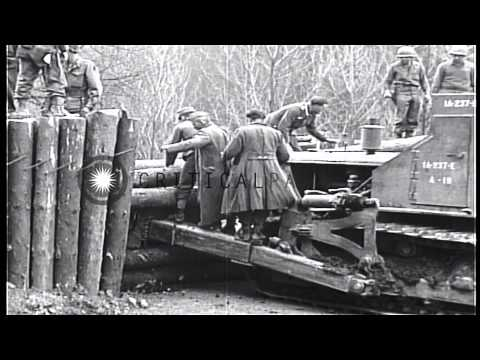 Bulldozer of US 237th Battalion Engineers, First US Army, VII Corps, clears road ...HD Stock Footage