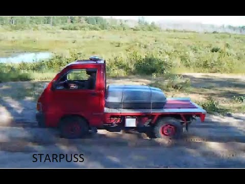 *****1990 hijet  daihatsu hijet  first test run off road. Stock 660cc truck stock tires. 4x4