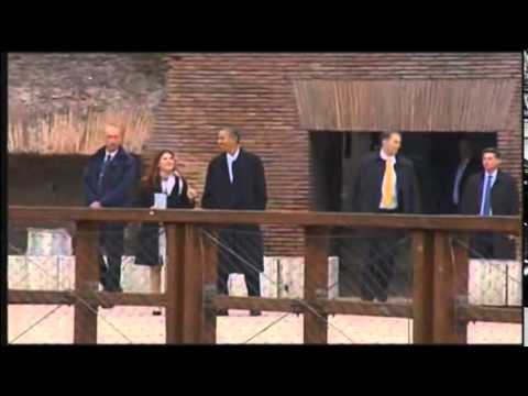 Obama watches sun set at Rome's Colosseum