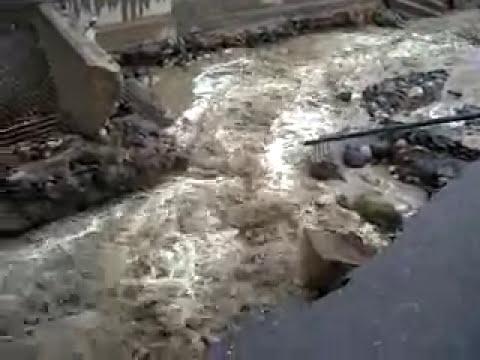 Puente destruido por el alud en El Rodeo