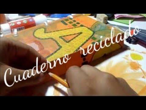 Cuaderno reciclado con tapas de plástico como anillas. /recycled notebook with