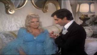 "Mae West & Timothy Dalton sing ""Love Will Keep Us Together"""