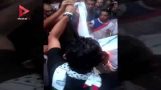 حرق علم إسرائيل في وقفة أمام السفارة الفلسطينية بالقاهرة