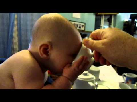 baby drinks tea from bone china   8969.MOV