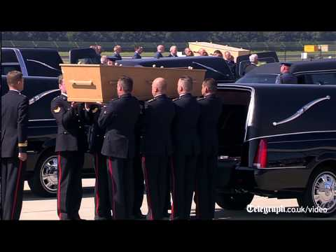 MH17: bodies from Malaysia Airlines flight arrive back in the Netherlands