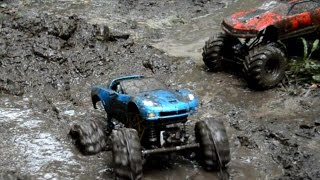 High Volts RC - 2 Chevy Monster Trucks Mudding - Sloppy Mud Hole Part 1
