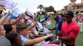 Tiger Woods signs autographs for fans