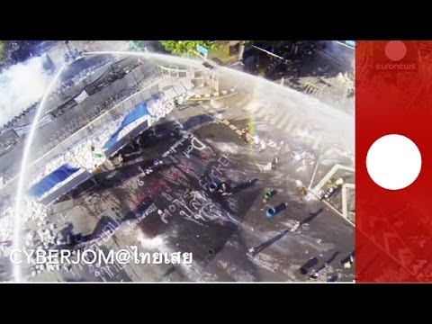 Drone footage: Thailand protesters try to break barricades, police answer with water cannons