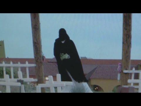 Grim Reaper visits Albuquerque cemetery