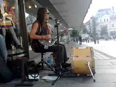 John Fogerty - Green River (one man band, street musician)