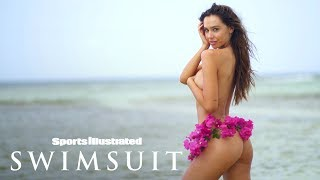 Alexis Ren Wears Nothing But A Bikini Bottom Made Of Flowers | Candids | Sports Illustrated Swimsuit