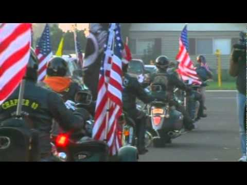 Hundreds ride with boy to show support for his US-flag-decorated bike after school banned it