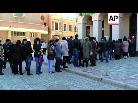 Long queues at some banks in Crimea with customers uncertain over currency