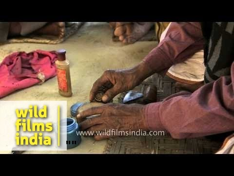 See how an Indian sadhu presses weed and makes his 'Chillum'