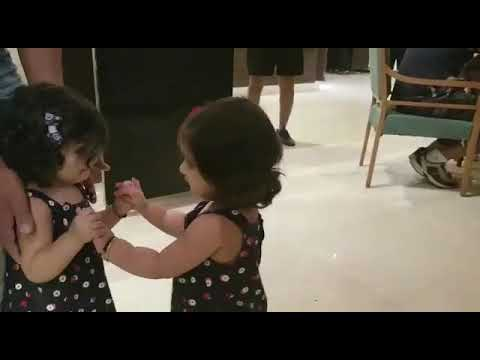Twins Bella and Vienna hug for the first time. 😄