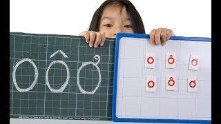 Bé tập viết chữ cái, đọc chữ cái O, Ô, Ơ tiếng việt lớp 1