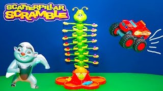 Playing Scaterpillar Scramble with  Lion Guard and Blaze with the Assistant