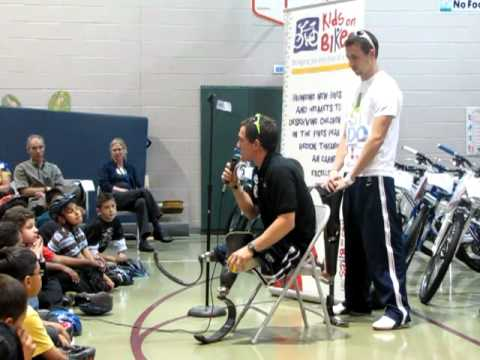 U.S. Paralympic double gold medalist Rudy Garcia-Tolson speaks at Sand Creek Elementary