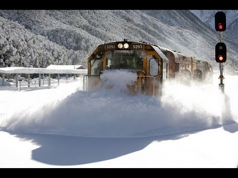 Spectacular footage Train plowing through deep snow  Arthurs Pass
