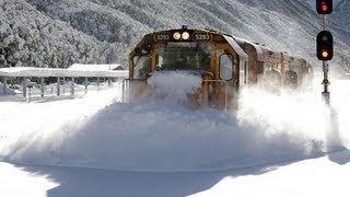 Spectacular footage Train plowing through deep snow  Arthurs Pass
