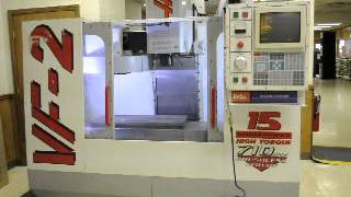 Iverson & Co. Haas VF-2 Vertical Machining Center with programmable coolant nozzle and chip auger