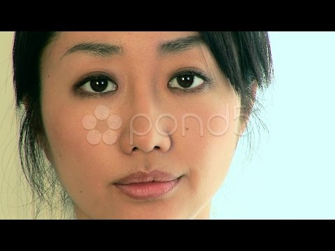 Close Up Portrait Of Smiling Young Asian Woman Face. Stock Footage