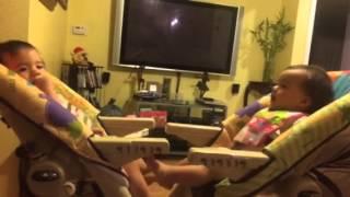 Twins playing footsie