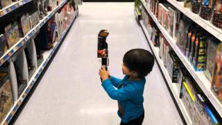 Little Kid With Laser Sable Toy (Star Wars)