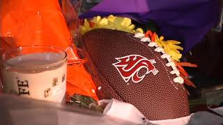 WSU community honors quarterback with candlelight vigil