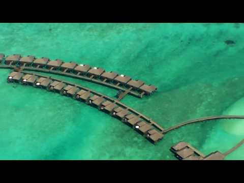 Seaplane flight over Maldivian Atolls from Sun Island Resort to Male