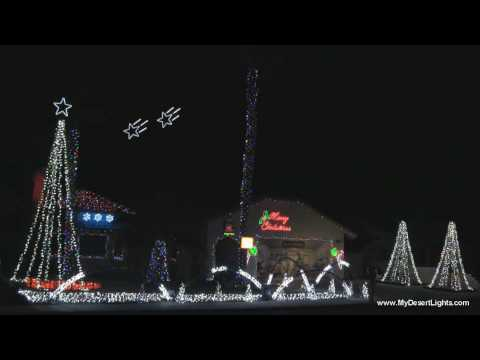 Simmons Family 50,000 LED Lights Dancing to Rockin' Around The Christmas Tree by Brenda Lee (2009)