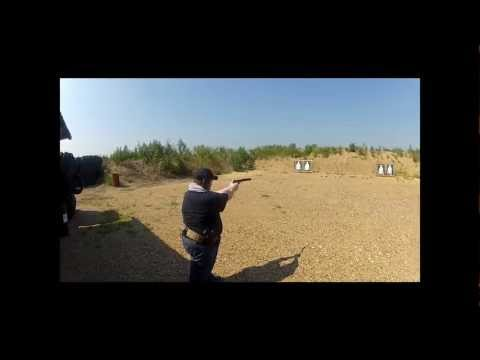 Tom shooting a silenced Nighthawk.wmv