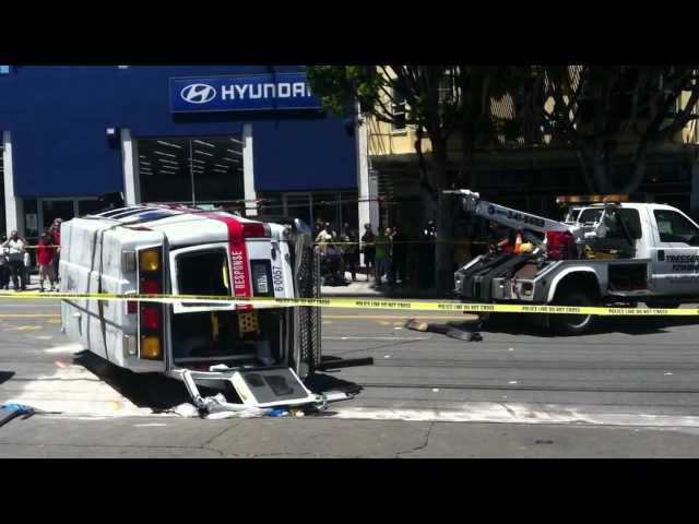 Tow truck rights flipped ambulance at 16th & South Van Ness