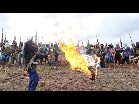 Armed Christian group sets terrorist group's flag on fire