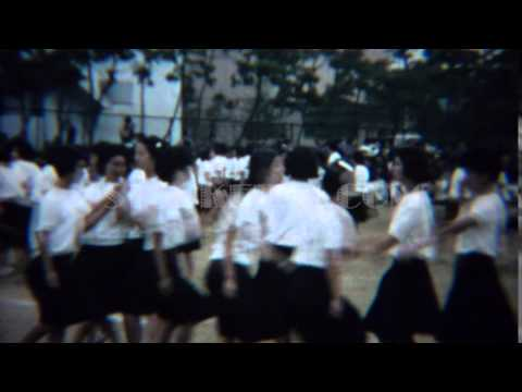 1961: Asian schoolgirl synchronized dancing competition showcase. TOKYO, JAPAN