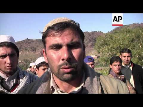 Funeral for one of 21 policemen believed kidnapped, shot by Taliban