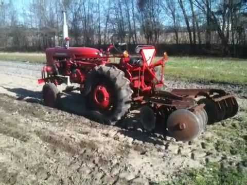 Discing with a International Farmall 140