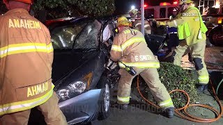 Crash With Tow-Truck Traps Driver In Anaheim