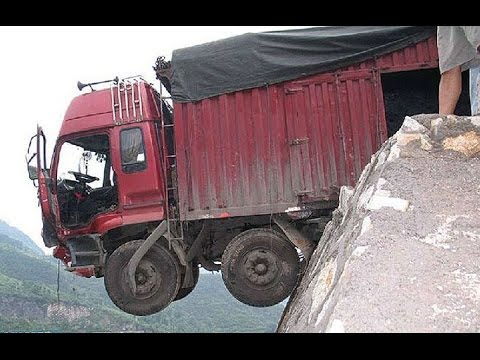 Truck falls off cliff due to overload.