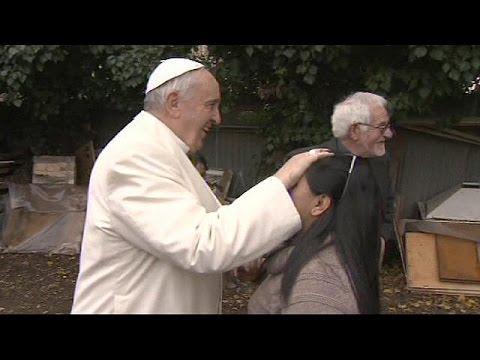 Pope Francis make surprise shantytown visit - no comment