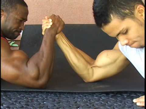 Bodybuilders dueling biceps arm wrestle