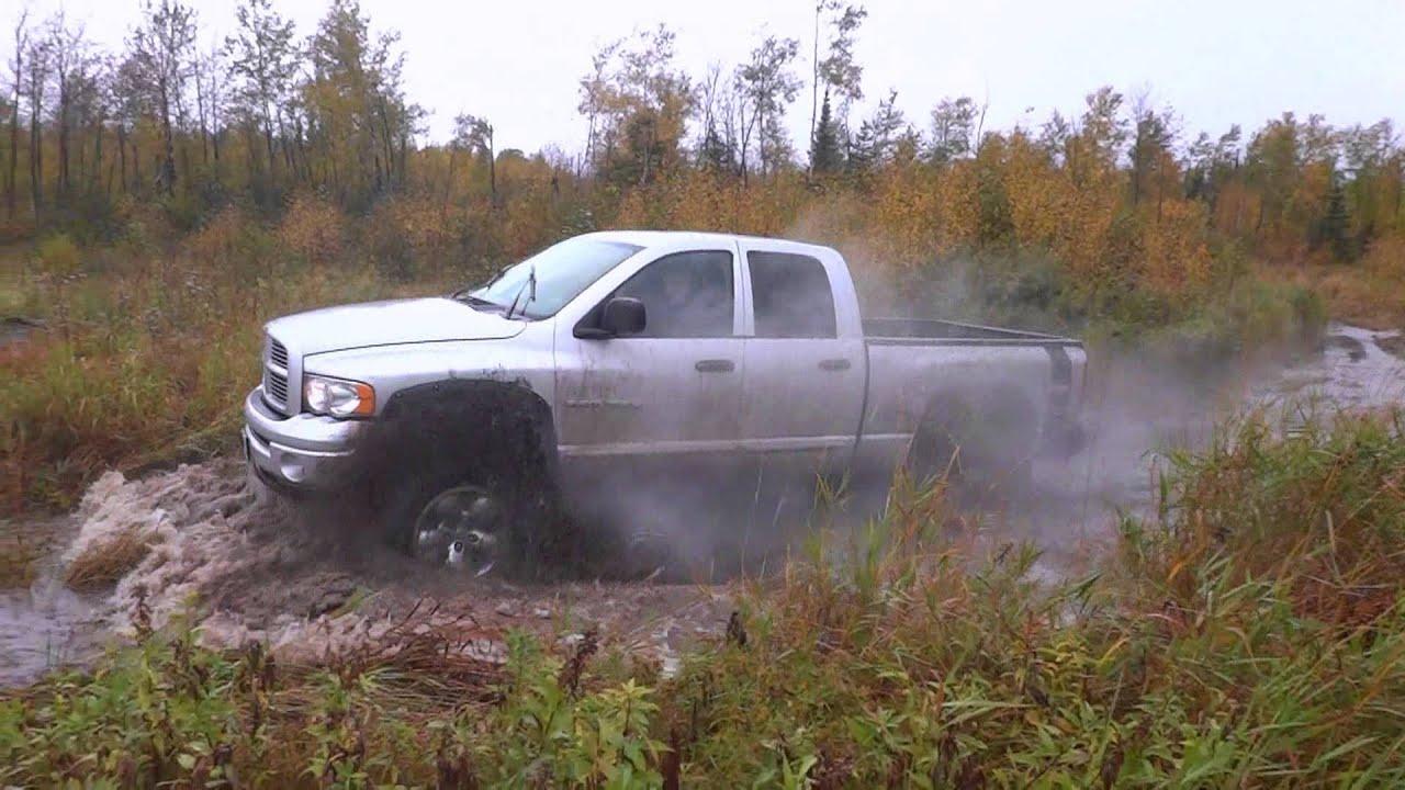 "2005 Dodge Ram Hemi 8"" lift kit 35"" tires off road mudding - YouTube"