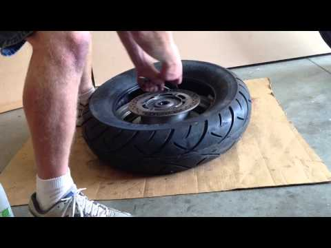 Removing and replacing a motorcycle tire from the rim.