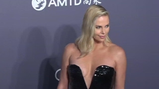 Theron pleads for AIDS work in South Africa