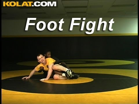 Foot Fight Bottom Leg Escape KOLAT.COM Wrestling Techniques Moves Instruction Image 1