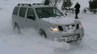 Nissan Pathfinder and Subaru Forester goes over snowbank